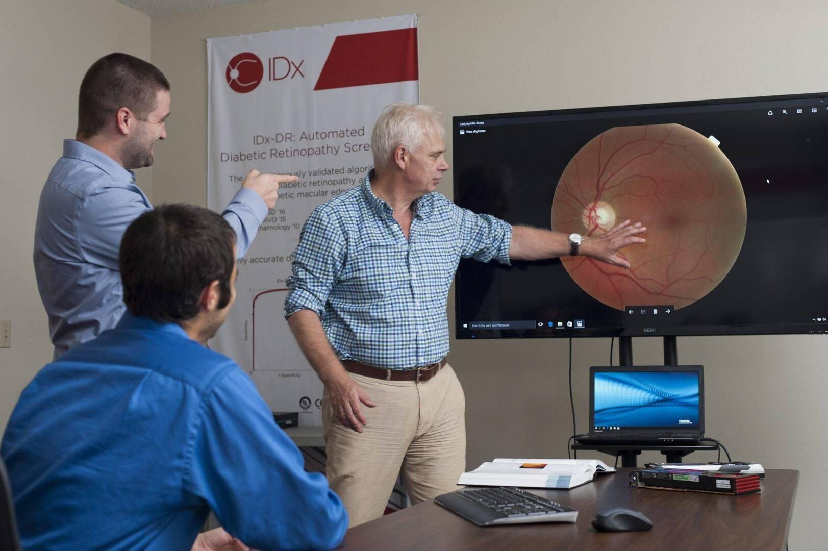 Dr. Michael Abramoff with IDx staff