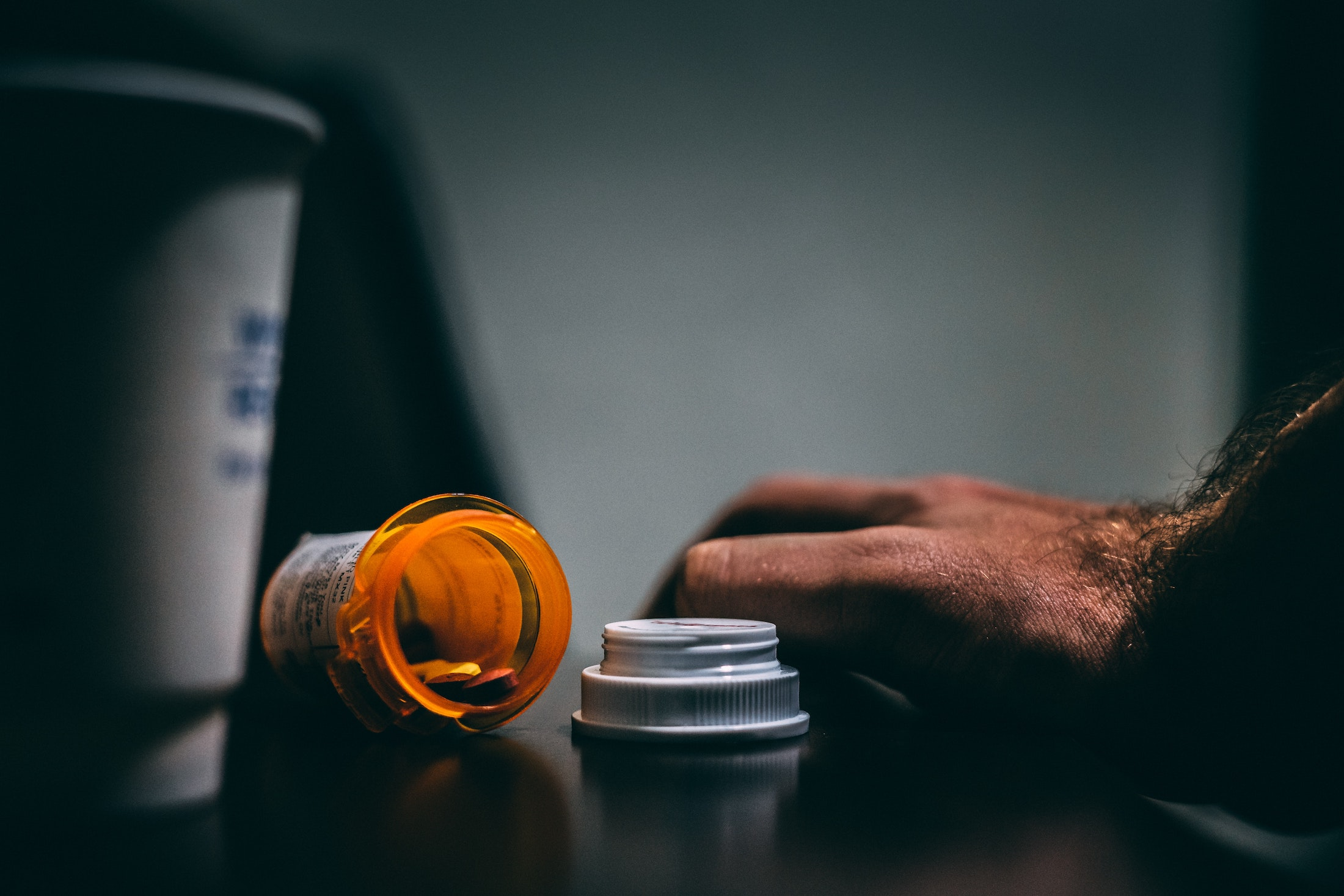 orange tipped over pill bottle