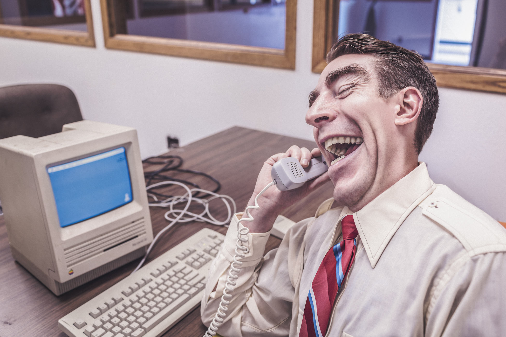 comical photo depicting guy working from 1970s office