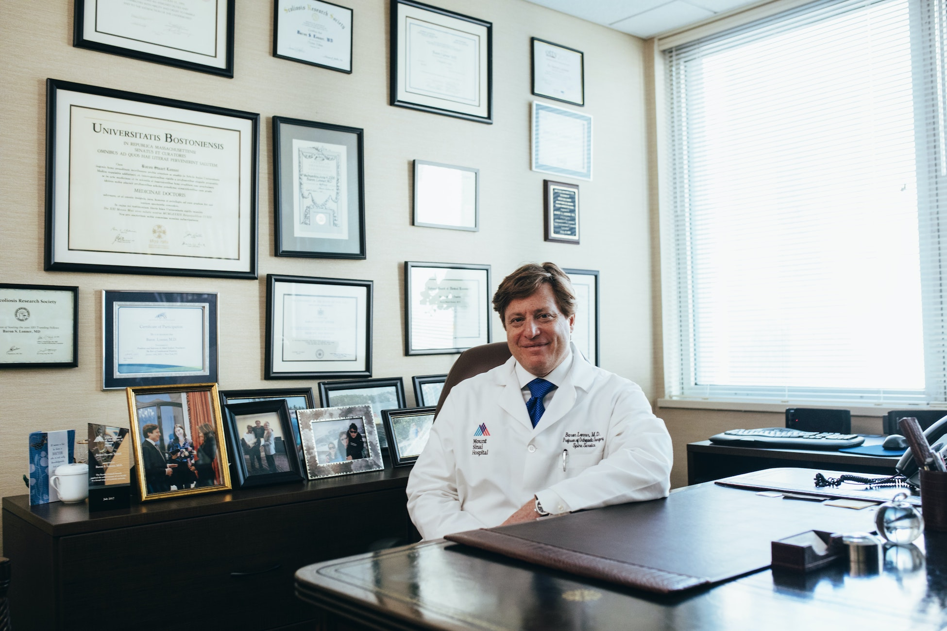 doctor sits in his office