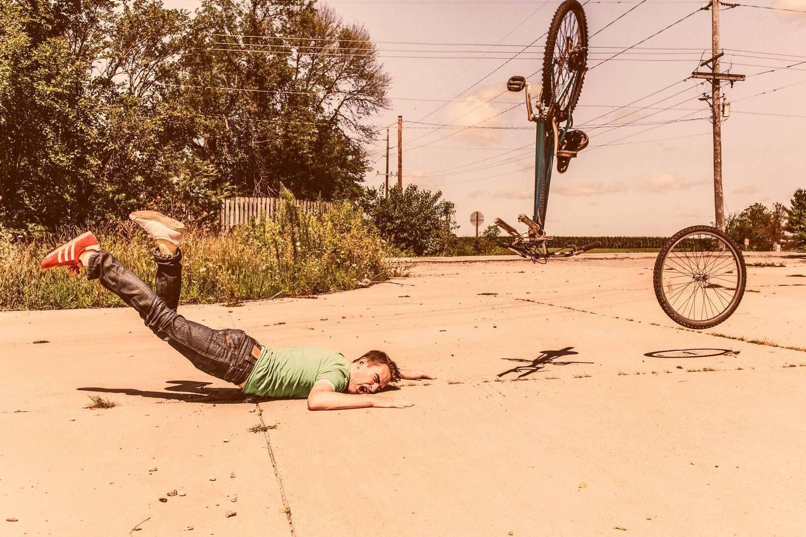 guy crashing on his bike