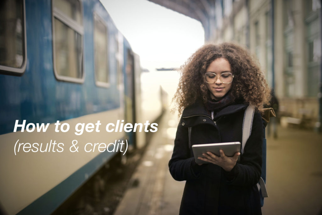 Woman in black coat traveling. Text on photo reads: how to get clients (results & credit)