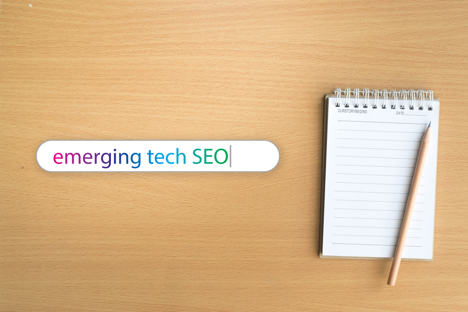 "A notebook sitting on a desk next to search bar that says ""emerging tech SEO"""