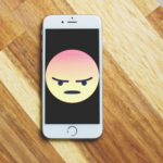 Angry emoji on smart phone screen