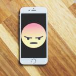 Angry emoji on smart phone screen