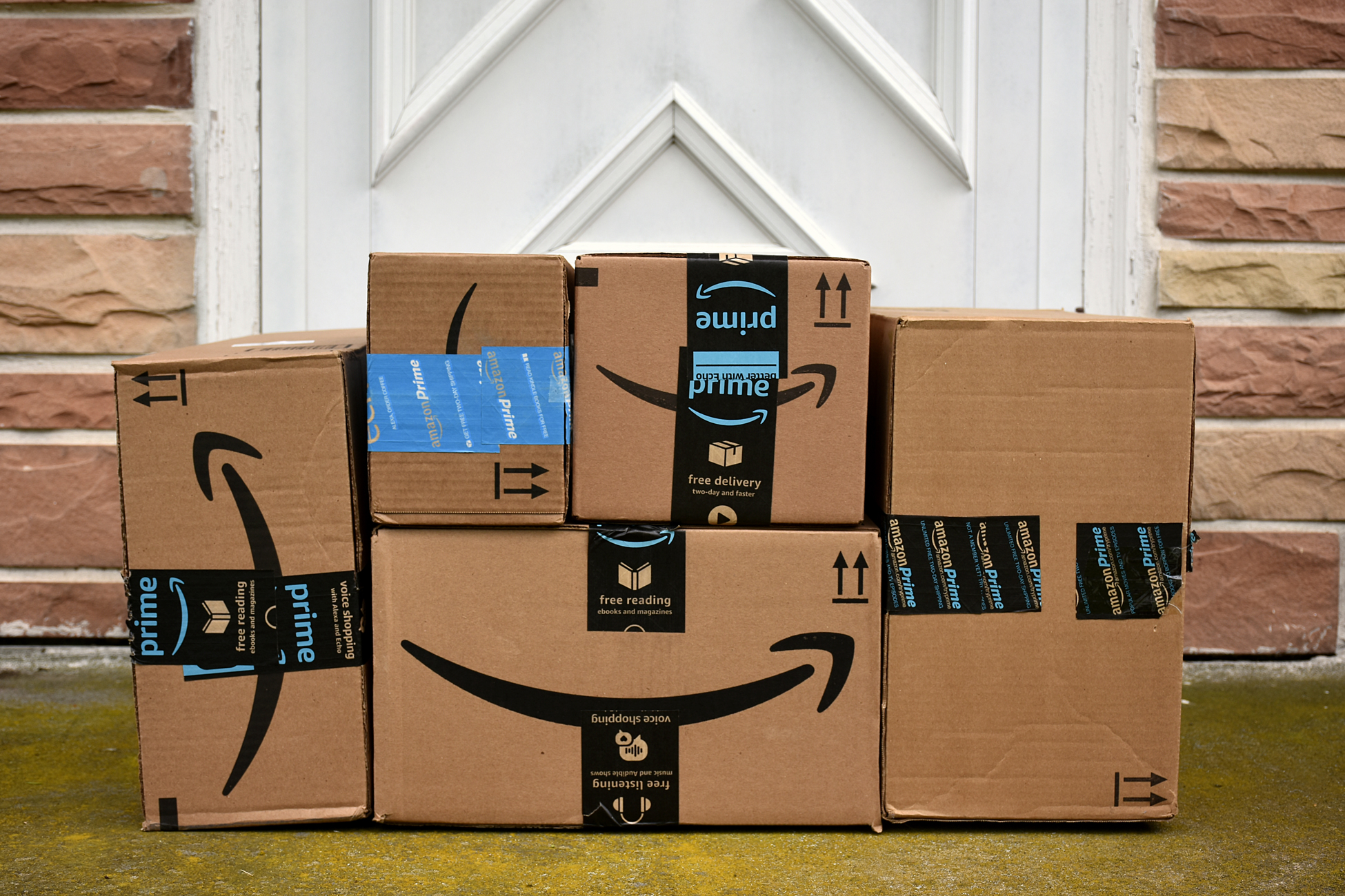 Amazon boxes at someones doorstep