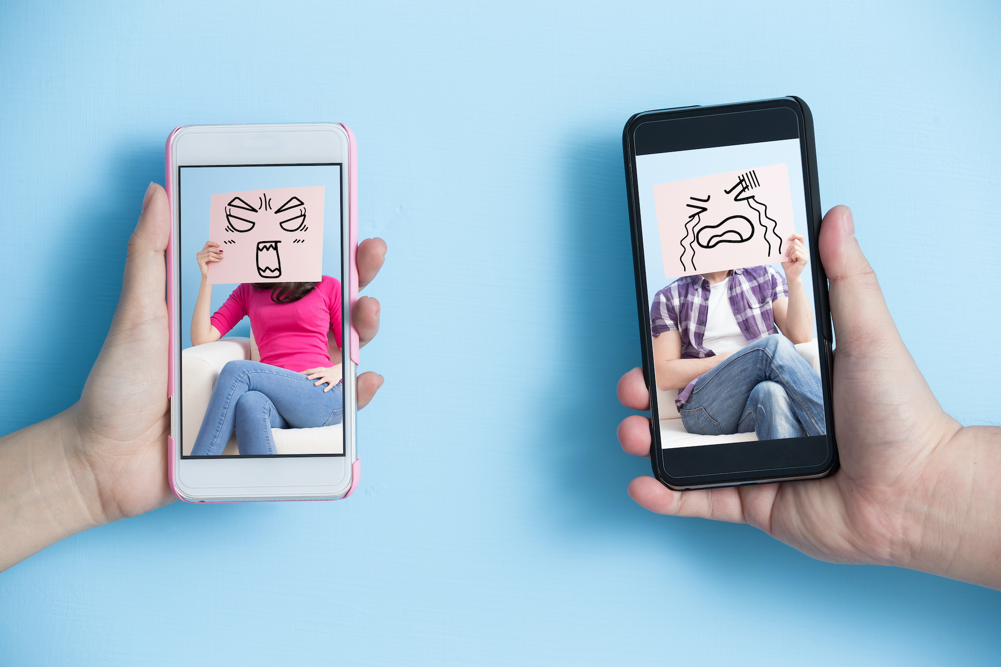 Two phones depict angry and sad emotions on their screens