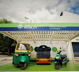 Sun Mobility's battery swap vending machine pictured alongside Tuk-Tuk and moped