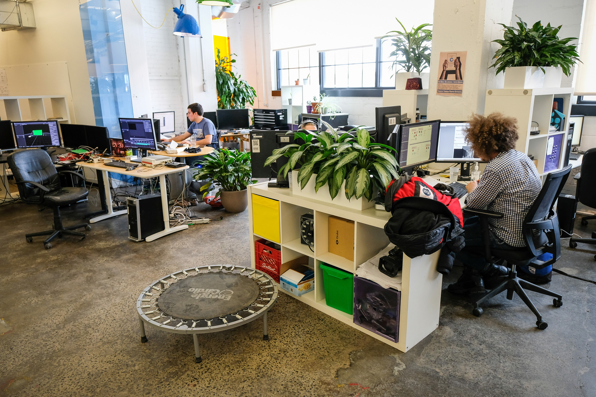 startup office with employees working