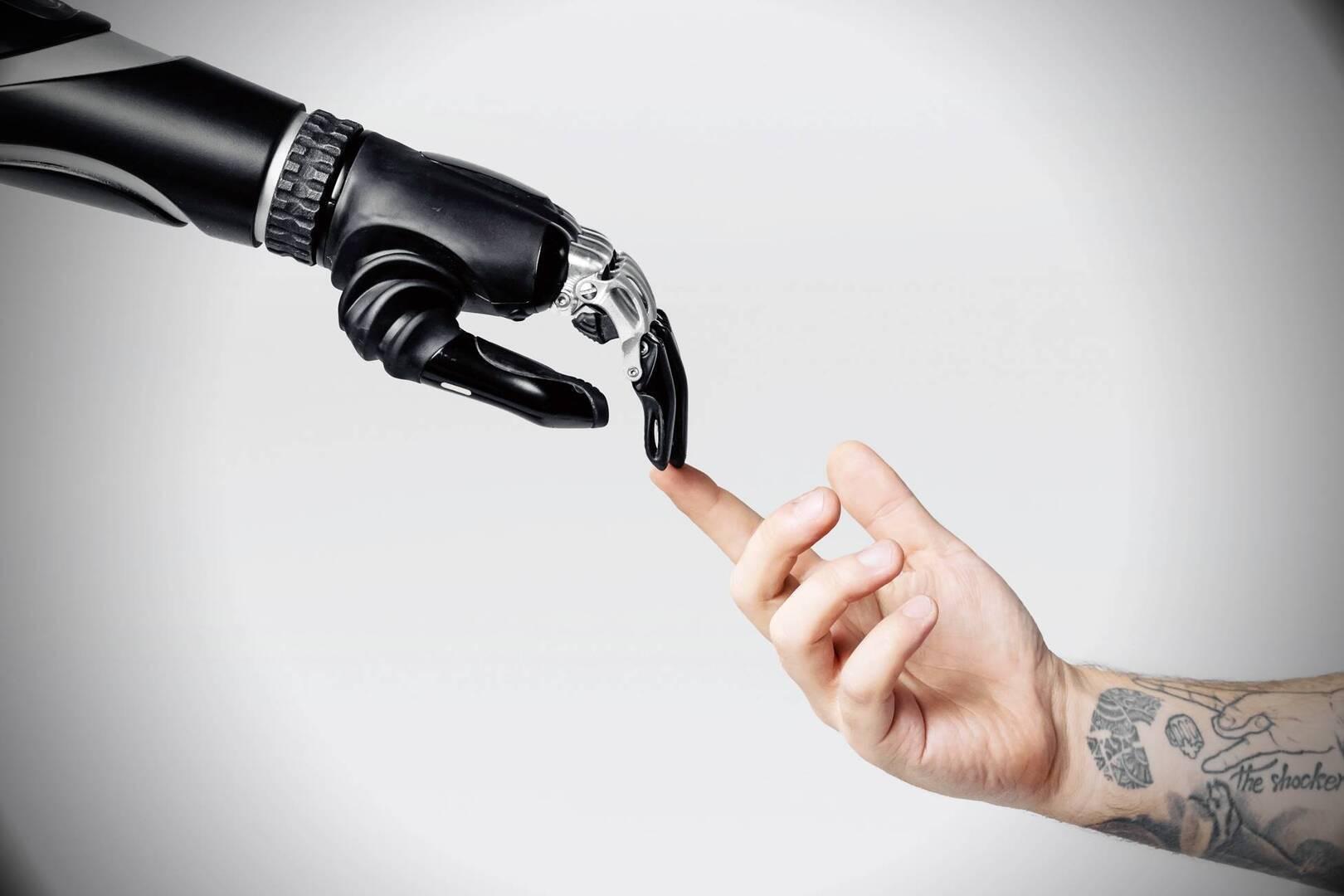 robot hand touching a human hand