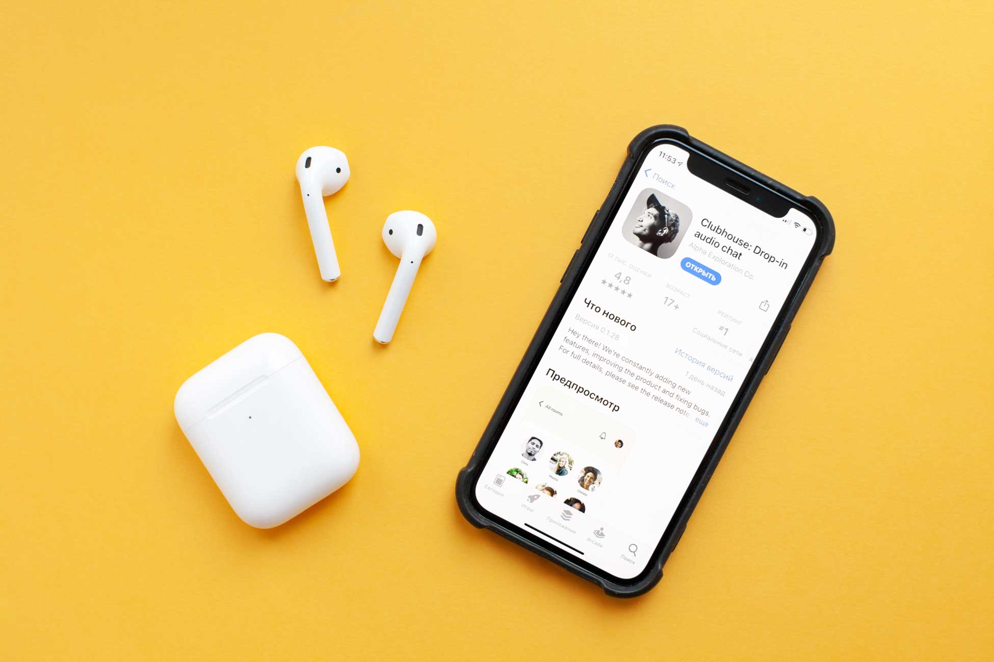 Clubhouse app on iPhone with headphones