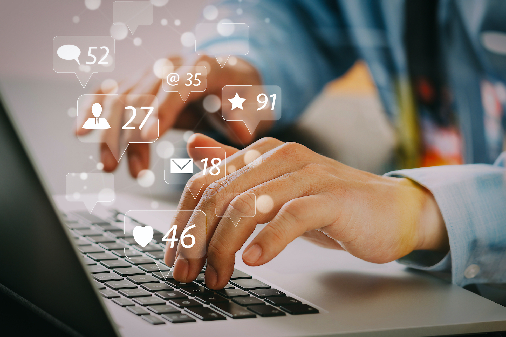 Hands typing on a keyboard, with social engagement icons.
