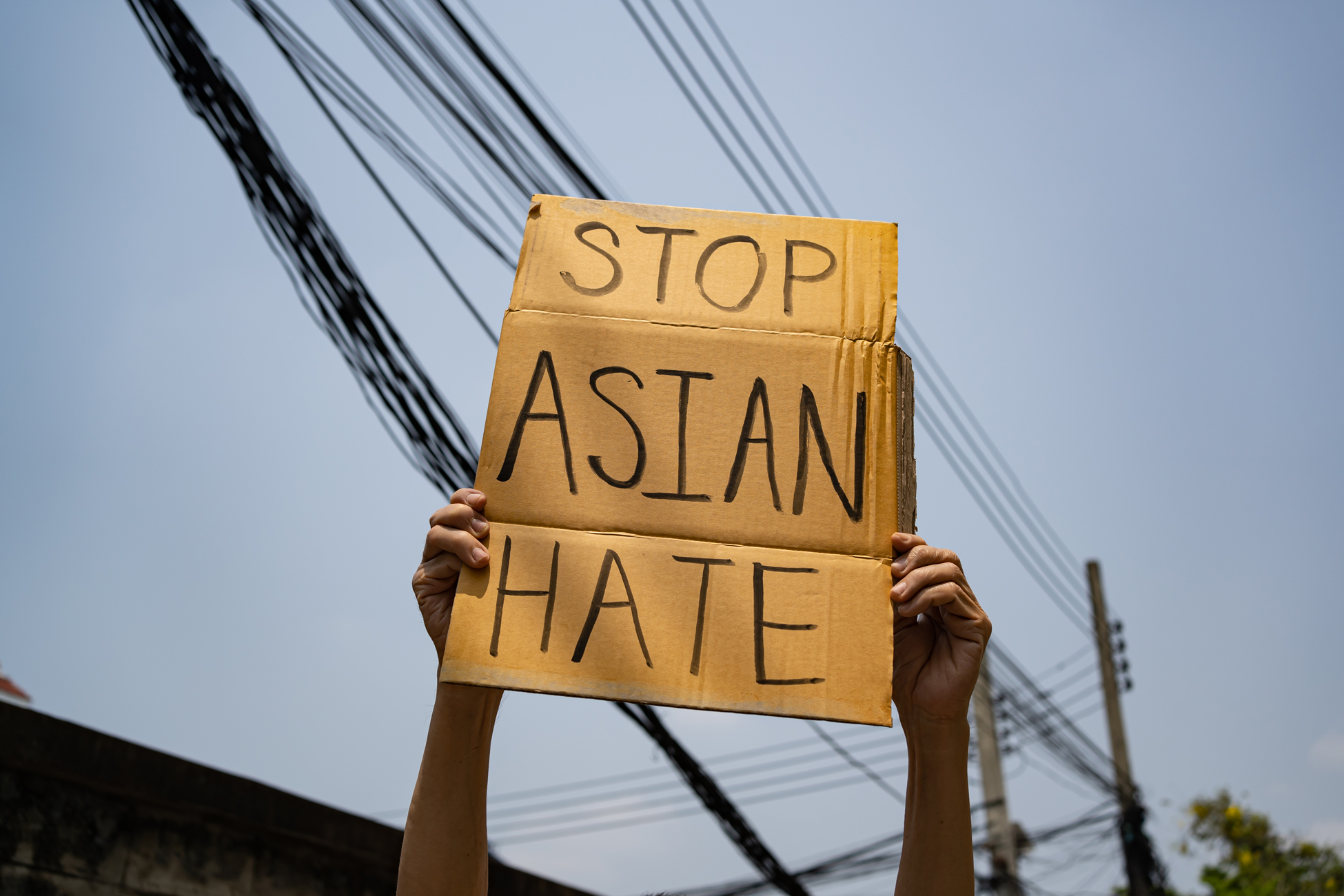 Someone holding a stop asian hate sign